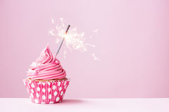 pink-cupcake-sparkler-decorated-49510484